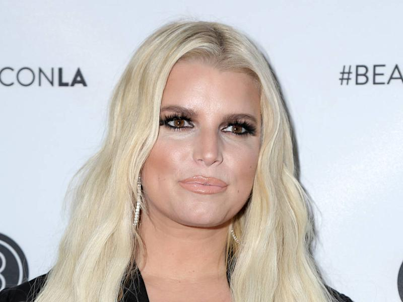 Jessica Simpson was hospitalised for nine days after tummy tuck surgery