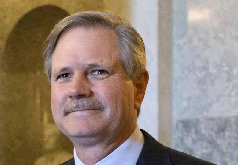 FILE - In this June 21, 2013 file photo, Sen. John Hoeven, N.D., leaves the Senate chamber on Capitol Hill in Washington. At the start of a crucial week for far-reaching immigration legislation backed by the White House, the Senate headed Monday for the first test vote on the measure offering the prize of U.S. citizenship to millions and pouring new technology and manpower into the border. (AP Photo/J. Scott Applewhite, File)