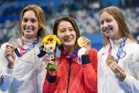 Gold medalist Yui Ohashi, centre, of Japan, stands with silver medalist Alex Walsh of the United States and bronze medalist Kate Douglass, right, of the United States, right, after the women's 200-meter individual medley final at the 2020 Summer Olympics, Wednesday, July 28, 2021, in Tokyo, Japan. (AP Photo/Martin Meissner)
