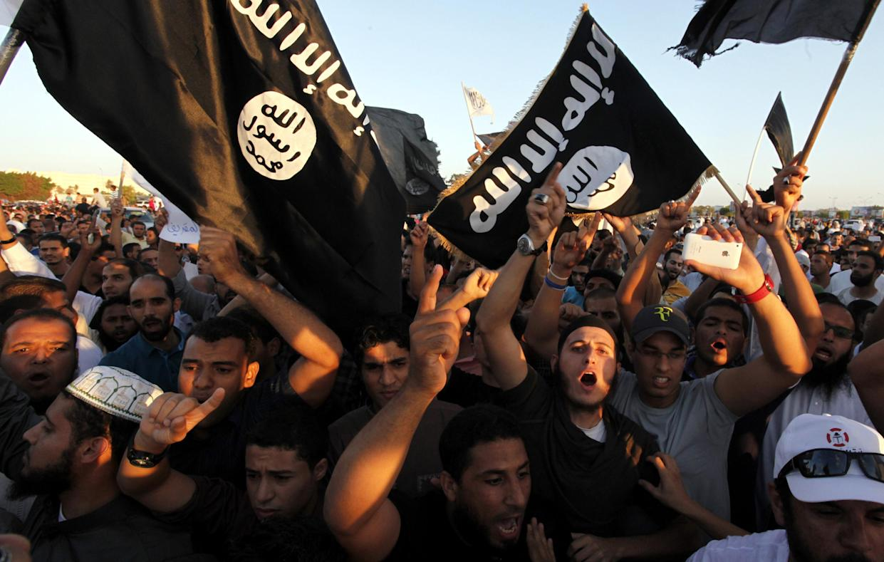 Followers of the Ansar al-Sharia group and other Islamic militias demonstrate against a film and a cartoon denigrating the Prophet Muhammad, Benghazi, Libya, Sept. 21, 2012. Some members of Ansar al-Sharia, one of Libya's most powerful Islamic factions, later joined ISIS. (Photo: Mohammad Hannon/AP)