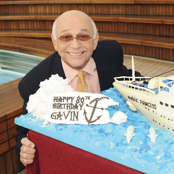 """This 2011 photo provided by Princess Cruises shows Gavin MacLeod celebrating his eightieth birthday luncheon aboard the Golden Princess. MacLeod's autobiography, """"This is Your Captain Speaking,"""" will be released Tuesday, Oct. 22, 2013. (AP Photo/Princess Cruises)"""