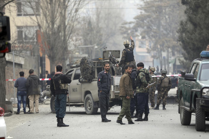 Security personnel inspect the site of a bomb attack in Kabul, Afghanistan, Saturday, Feb. 20, 2021. Three separate explosions in the capital Kabul on Saturday killed and wounded numerous people an Afghan official said. (AP Photo/Rahmat Gul)