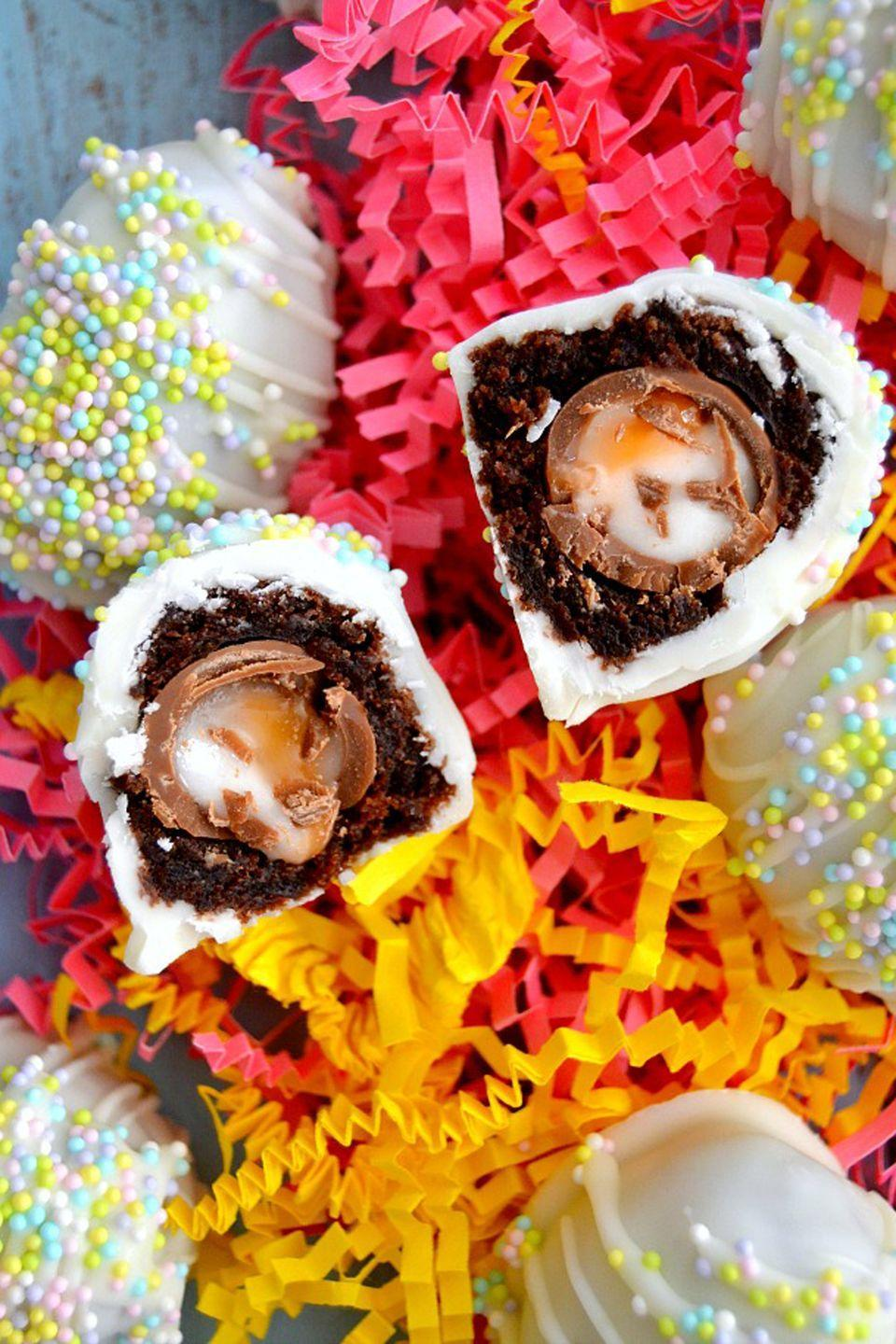 """<p>Cover a Cadbury Creme Egg with brownie batter and a layer of white chocolate for a super-sweet bite. </p><p><em><a href=""""https://thedomesticrebel.com/2015/03/20/cadbury-creme-egg-brownie-bombs/"""" rel=""""nofollow noopener"""" target=""""_blank"""" data-ylk=""""slk:Get the recipe from The Domestic Rebel »"""" class=""""link rapid-noclick-resp"""">Get the recipe from The Domestic Rebel »</a></em></p>"""