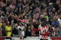 Brentford's Yoane Wissa celebrates after scoring his side's third goal during the English Premier League soccer match between Brentford and Liverpool at the Brentford Community Stadium in London, Saturday, Sept. 25, 2021. (AP Photo/Rui Vieira)