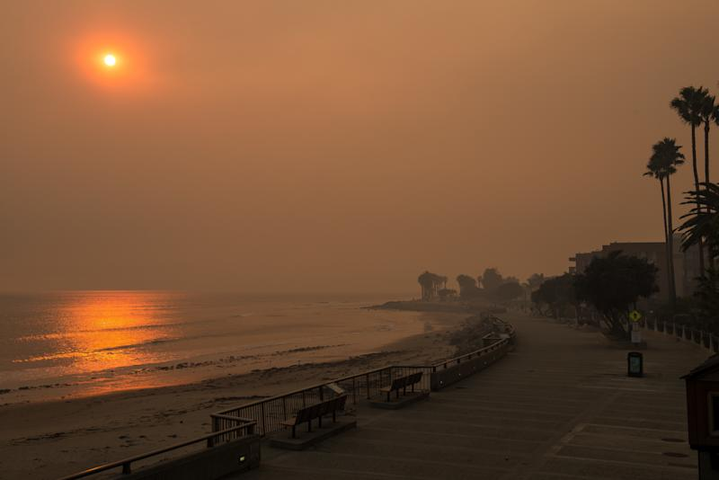 The beach next to the Ventura Pier is seen surrounded by smoke on Wednesday. (Anadolu Agency via Getty Images)