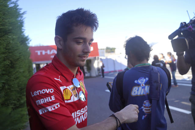 Ferrari driver Charles Leclerc of Monaco arrives at the paddock ahead of the Japanese Formula One Grand Prix at Suzuka Circuit in Suzuka, central Japan, Sunday, Oct. 13, 2019. (AP Photo/Toru Hanai)