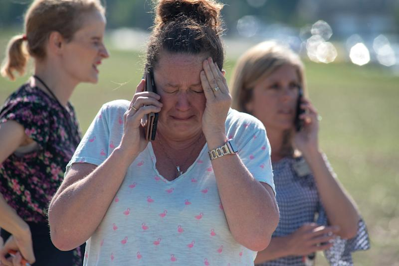Instructional Assistant Paige Rose reacts outside Noblesville West Middle School after the shooting.