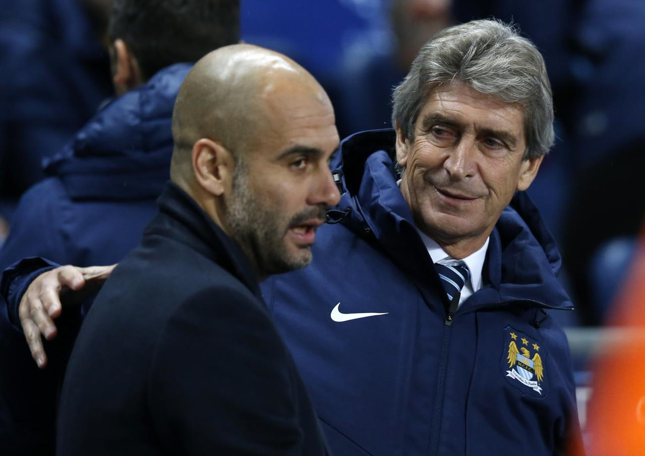 FILE - In this Tuesday, Nov. 25, 2014 file photo, Manchester City's coach Manuel Pellegrini, right, speaks with Bayern Munich's coach Pep Guardiola before their Champions League group E soccer match at the Etihad Stadium, in Manchester, England. Manchester City says Pep Guardiola will join the club as its manager on a three-year contract starting next season.  Guardiola will replace Manuel Pellegrini, who announced at a news conference on Monday Feb. 1, 2016 that he would be leaving at the end of the season. (AP Photo/Jon Super, File)