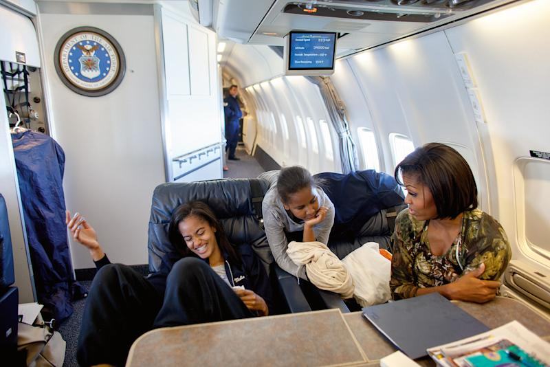 First Lady Michelle Obama on board BrightStar gets helps from Sasha and Malia on rehearsing her lines for the iCarly Show while headed to Los Angeles, California, June 13, 2011. [Photo: Official White House Photo by Lawrence Jackson]