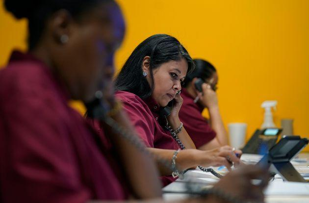 Tnisha Nation, left, Sandrea Guerrero, center, and Elena Mojica reach out to families in the San Antonio Independent School District, Tuesday, June 8, 2021, in San Antonio. (AP Photo/Eric Gay) (Photo: Eric Gay via AP)