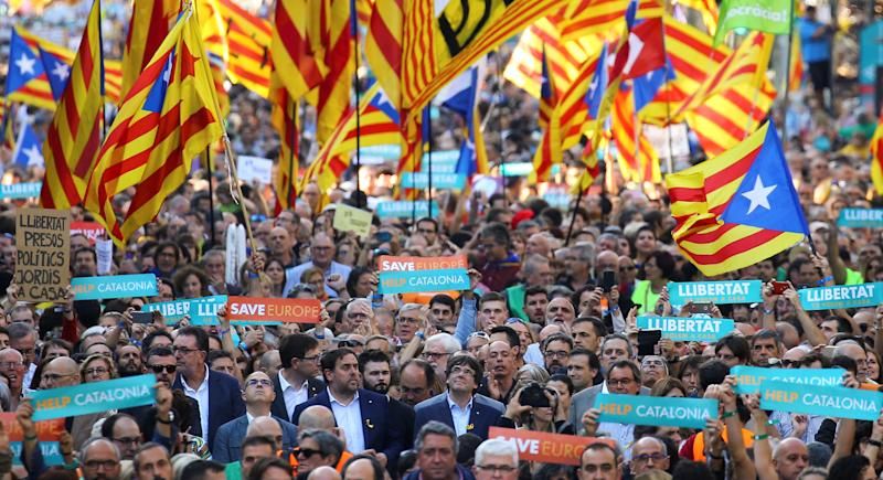 Puigdemont and other Catalan regional government members attend a demonstrationorganized by Catalan pro-independence movements in Barcelona on Oct. 21. (Ivan Alvarado / Reuters)