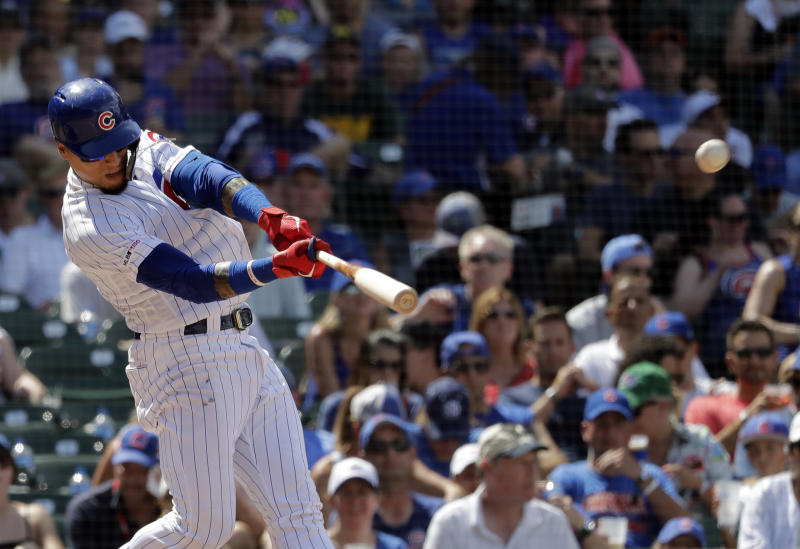 Chicago Cubs' Javier Baez hits a three-run home run during the fourth inning of a baseball game against the San Diego Padres in Chicago, Saturday, July 20, 2019. (AP Photo/Nam Y. Huh)