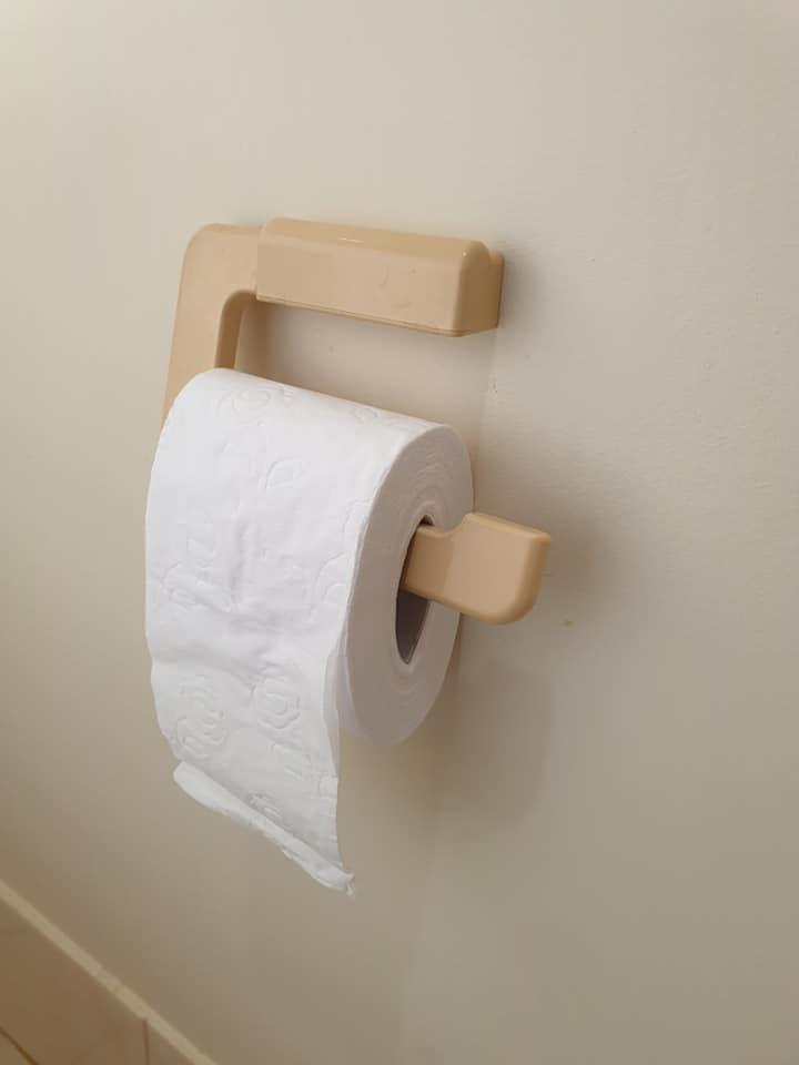 Squashed toilet paper roll hack slows use of toilet paper.