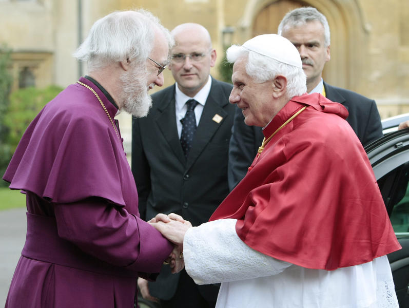 FILE -- In this photo from files taken at Lambeth Palace in London, on Sept. 17, 2010, Pope Benedict XVI, right, meets Britain's Archbishop of Canterbury Rowan Williams. Williams is stepping down at the end of the year, calling an end to a tumultuous decade as leader of a global Anglican Communion that has been sharply divided over sexuality and gender. Williams, 61, renowned for his formidable learning, announced Friday he will take up a new post as master of Magdalene College, Cambridge. (AP Photo/Gregorio Borgia, file)