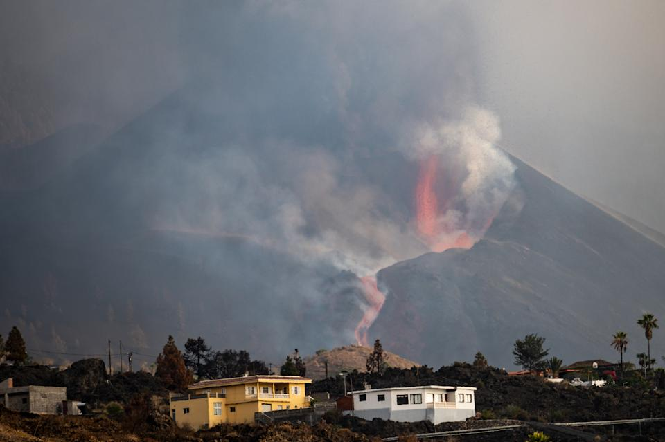 LA PALMA, SPAIN - OCTOBER 09: Ash and smoke rise from the Cumbre Vieja Volcano on October 9, 2021 in La Palma, Spain. The Cumbre Vieja Volcano erupted on September 19, shutting down the airport twice due to the volcanic ash. The numerous lava flows destroyed hundreds of hectares, but also formed peninsulas of volcanic rock, extending the surface of the island. (Photo by Marcos del Mazo/Getty Images)