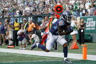 Tennessee Titans wide receiver Cameron Batson runs in a touchdown during the second half of an NFL football game against the New York Jets, Sunday, Oct. 3, 2021, in East Rutherford, N.J. (AP Photo/Seth Wenig)