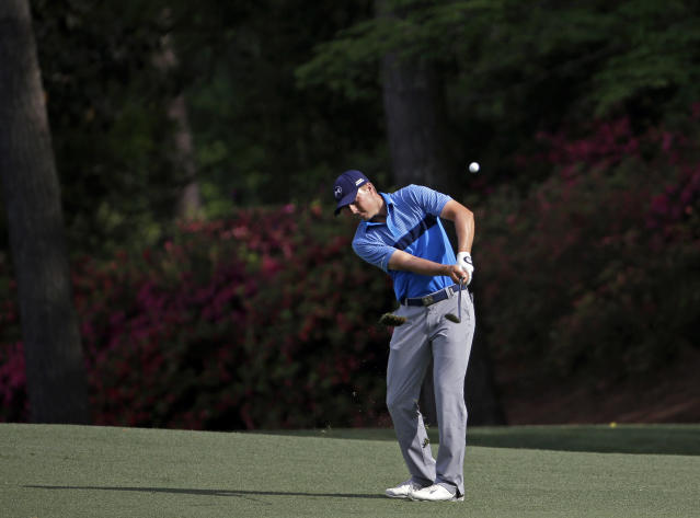 Jordan Spieth hits a chip shot during the first round of the Masters golf tournament Thursday, April 9, 2015, in Augusta, Ga. (AP Photo/David J. Phillip)