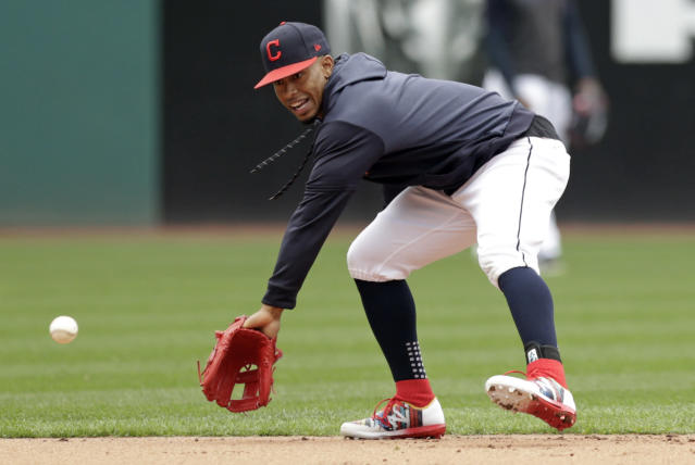 Cleveland Indians' Francisco Lindor fields a ball during batting practice before the first game of a baseball doubleheader against the Atlanta Braves, Saturday, April 20, 2019, in Cleveland. Lindor is back after missing the season's first 18 games. (AP Photo/Tony Dejak)