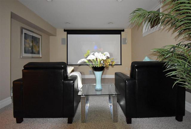 """<p><a href=""""https://www.zoocasa.com/sardis-bc-real-estate/4870775-5756-cheamview-crescent-sardis-bc-v2r0a1-r2210177"""" rel=""""nofollow noopener"""" target=""""_blank"""" data-ylk=""""slk:5756 Cheamview Cres., Chilliwack, B.C."""" class=""""link rapid-noclick-resp"""">5756 Cheamview Cres., Chilliwack, B.C.</a><br> There's even a movie theatre room in the finished basement.<br> (Photo: Zoocasa) </p>"""