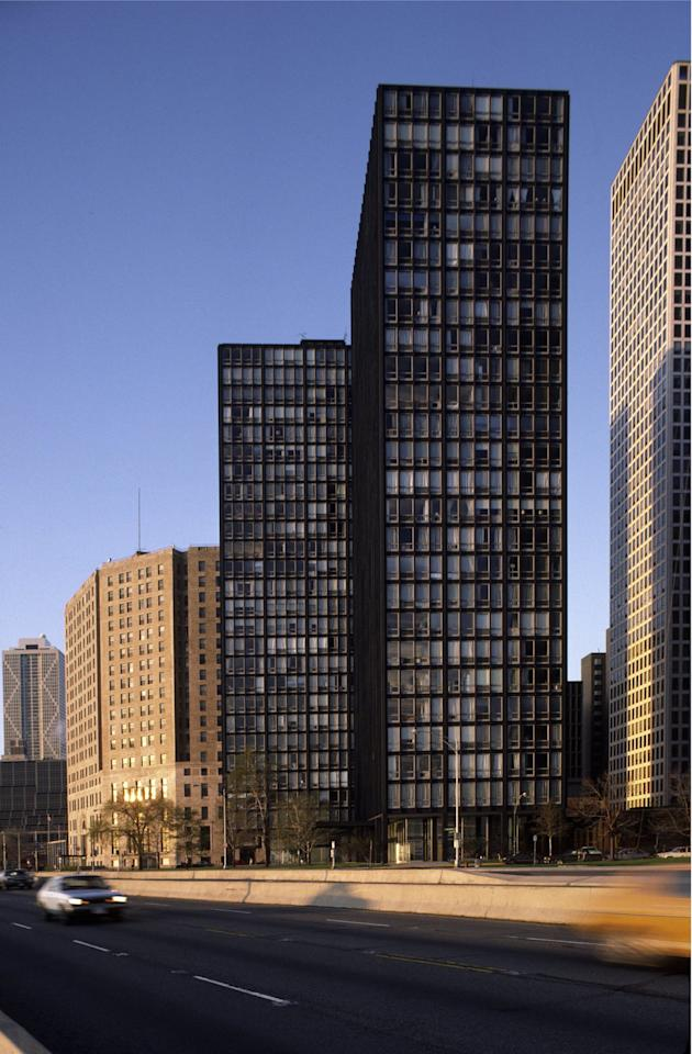 """<p>After emigrating from Germany, Ludwig Mies van der Rohe set up shop in Chicago. His designs for two Lake Shore Drive apartment buildings were shockingly plain and featured a steel and glass exoskeleton that would define a whole generation of skyscrapers. This was the first of a kind.</p><p><b>More: <a rel=""""nofollow"""" href=""""http://www.architecturaldigest.com/story/modern-architecture-that-have-serious-flaws?mbid=synd_yahoolife"""">5 Examples of Iconic Modern Architecture That Have Serious Flaws</a></b></p>"""
