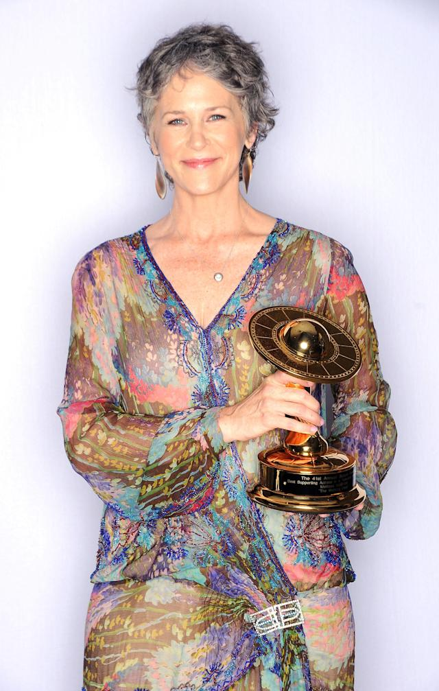 Melissa McBride poses with her award for Best Supporting Actress on Television in AMC's <i>The Walking Dead</i> at the 41st Annual Saturn Awards on June 25, 2015, in Burbank, Calif. (Photo: Jody Cortes/Getty Images)