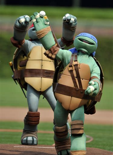 An a actor dressed as a Teenage Mutant Ninja Turtle throws out the ceremonial first pitch at Wrigley Field before a baseball game between the Pittsburgh Pirates and Chicago Cubs in Chicago, Sunday, Sept. 16, 2012. (AP Photo/Paul Beaty)