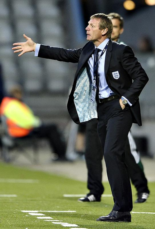(FILES) In a file picture taken on June 19, 2011 England coach Stuart Pearce gestures during the UEFA Under-21 European Championship group B football match England vs Czech Republic at the Viborg Stadium. Football Association chairman David Bernstein confirmed that England Under-21 manager Stuart Pearce would take charge of England's squad for the friendly against the Netherlands on February 29, 2012 following the resignation of Fabio Capello from the England top job.    (Photo by Scanpix/ Henning Bagger   ***denmark Out*** /AFP/Getty Images)