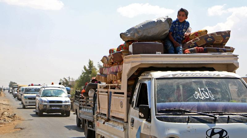 Syrians in a pick up truck head to safer areas in rebel-held Idlib province on September 6, 2018