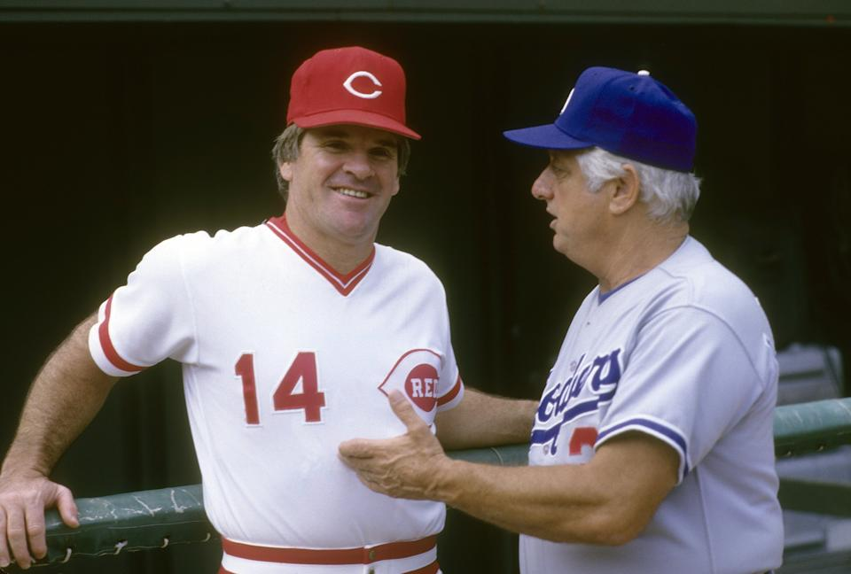Manager Pete Rose of the Cincinnati Reds talks with Manager Tommy Lasorda of the Los Angeles Dodgers before a MLB baseball game circa mid 1980's at Riverfront Stadium in Cincinnati, Ohio. Rose managed the Reds from 1984-89. (Photo by Focus on Sport/Getty Images)