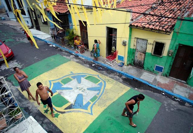 A street is decorated with the emblem of the Brazil soccer team during the 2014 soccer World Cup in Fortaleza, Brazil, Monday, June 16, 2014. (AP Photo/Marcio Jose Sanchez)
