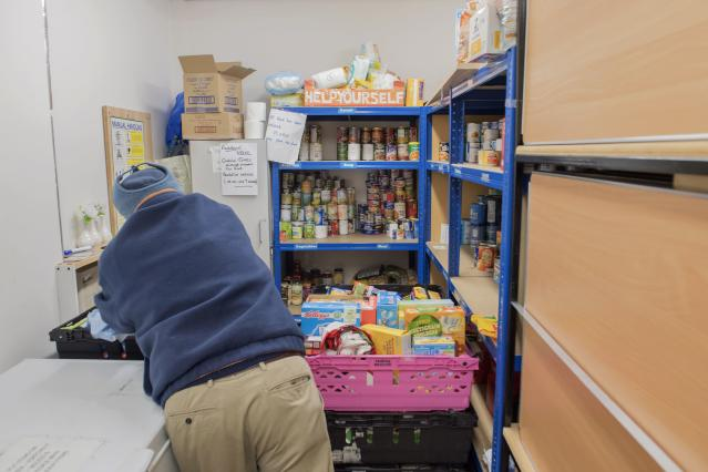 STALYBRIDGE, ENGLAND - JANUARY 28: A foodbank volunteer stores donations at St John's Church before distributing them to local foodbanks on January 28, 2019 in Stalybridge, England. The Tameside East foodbank is part of a nationwide network supported by The Trussell Trust, a charity working to combat poverty and hunger across the UK. The project was founded by local churches and community groups, working together towards stopping hunger in the area. (Photo by Anthony Devlin/Getty Images)
