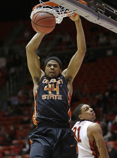 Oregon State's Devon Collier (44) dunks as Utah's Jordan Loveridge (21) looks on in the first half during an NCAA college basketball game on Thursday, March 7, 2013, in Salt Lake City. (AP Photo/Rick Bowmer)