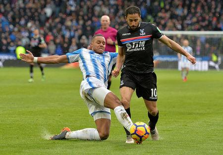 Soccer Football - Premier League - Huddersfield Town vs Crystal Palace - John Smith's Stadium, Huddersfield, Britain - March 17, 2018   Huddersfield Town's Mathias Jorgensen concedes a penalty against Crystal Palace's Andros Townsend    REUTERS/Peter Powell