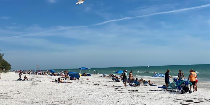 Sunbathers enjoy Sunset Beach in Treasure Island, Florida, on May 2, 2020. Beaches in the city just south of Tampa are to be officially open on May 4, following a shutdown because of the coronavirus pandemic.