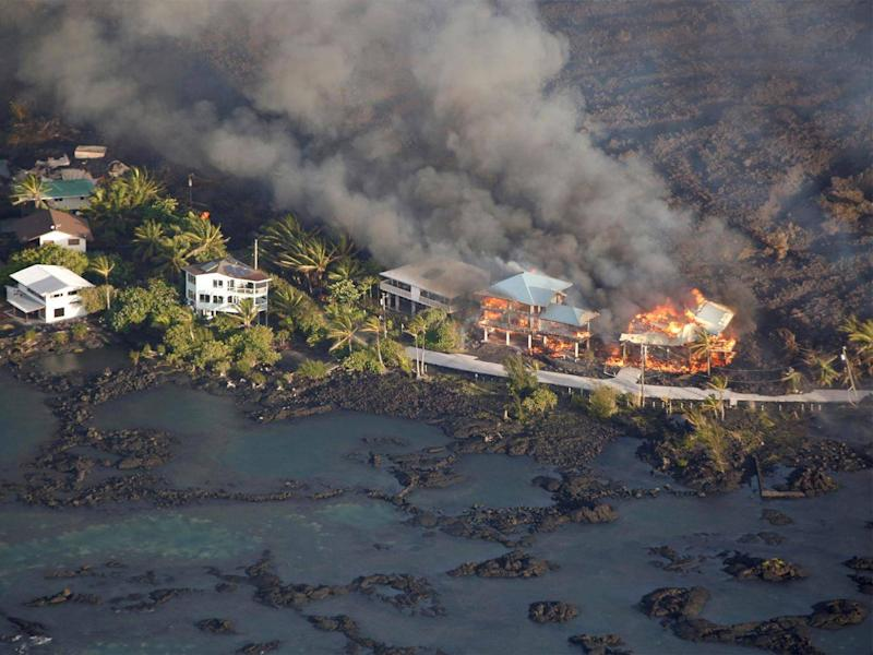Lava has destroyed homes and filled in the coastline almost a mile out from its original location (Reuters/Terray Sylvester)