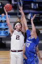 Gonzaga forward Drew Timme (2) shoots on Creighton center Ryan Kalkbrenner (32) in the first half of a Sweet 16 game in the NCAA men's college basketball tournament at Hinkle Fieldhouse in Indianapolis, Sunday, March 28, 2021. (AP Photo/Michael Conroy)