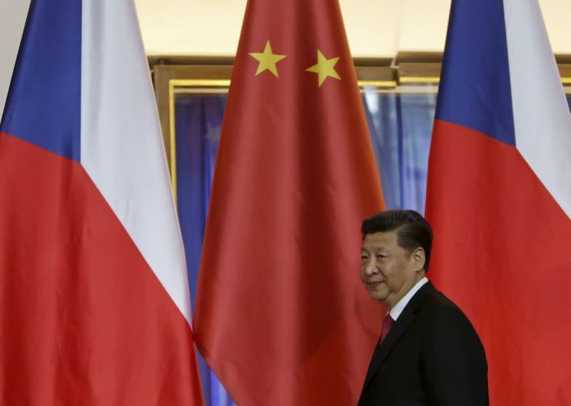 FILE PHOTO: Chinese President Xi Jinping leaves after a news conference at Prague Castle in Prague