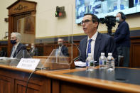 Treasury Secretary Steven Mnuchin gives an opening statement before a House Financial Services Committee hearing on Capitol Hill in Washington, Wednesday, Dec. 2, 2020. (Greg Nash/Pool via AP)