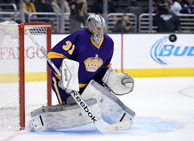 LOS ANGELES, CA - DECEMBER 07: Martin Jones #31 of the Los Angeles Kings watches the puck in goal during the game against the New York Islanders at Staples Center on December 7, 2013 in Los Angeles, California. (Photo by Harry How/Getty Images)
