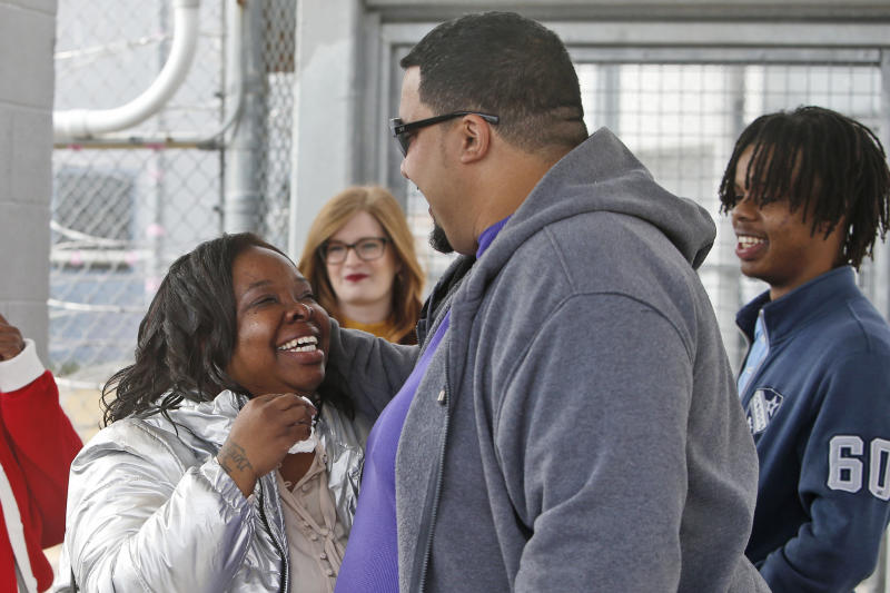 Tondalao Hall, left, celebrates with family members after being released from Mabel Bassett Correctional Center in McLoud, Okla., Friday, Nov. 8, 2019. Hall, who was convicted of failing to report her boyfriend for abusing her children, spent about 13 years longer in prison than he did for the abuse. (AP Photo/Sue Ogrocki)