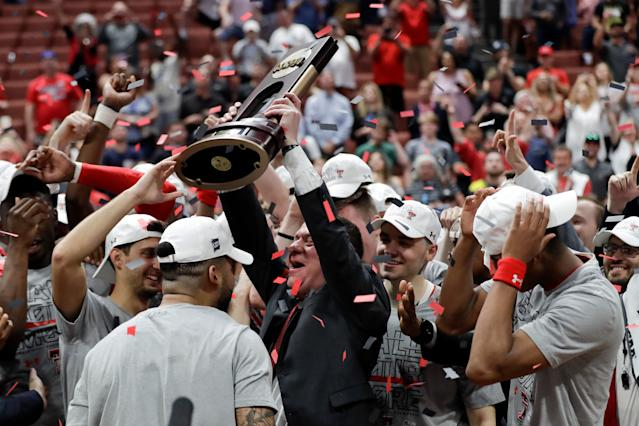 Texas Tech coach Chris Beard celebrates with the trophy after the team's win over Gonzaga during the West Regional final in the NCAA men's college basketball tournament Saturday, March 30, 2019, in Anaheim, Calif. Texas Tech won 75-69. (AP Photo/Marcio Jose Sanchez)