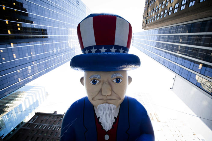 A giant Uncle Sam balloon is marched down Sixth Avenue during the 87th Annual Macy's Thanksgiving Day Parade in New York, Nov. 28, 2013. (Photo: John Minchillo/AP)
