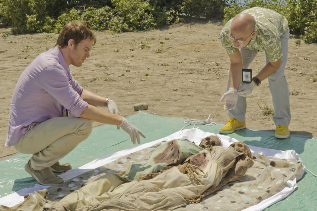 "C.S. Lee as Vince Masuka and Michael C. Hall as Dexter Morgan in the ""Dexter"" episode, ""Swim Deep."""