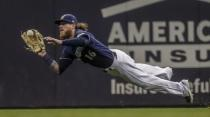 Milwaukee Brewers' Ben Gamel makes a diving catch on a ball hit by Seattle Mariners' J.P. Crawford during the sixth inning of a baseball game Tuesday, June 25, 2019, in Milwaukee. (AP Photo/Morry Gash)