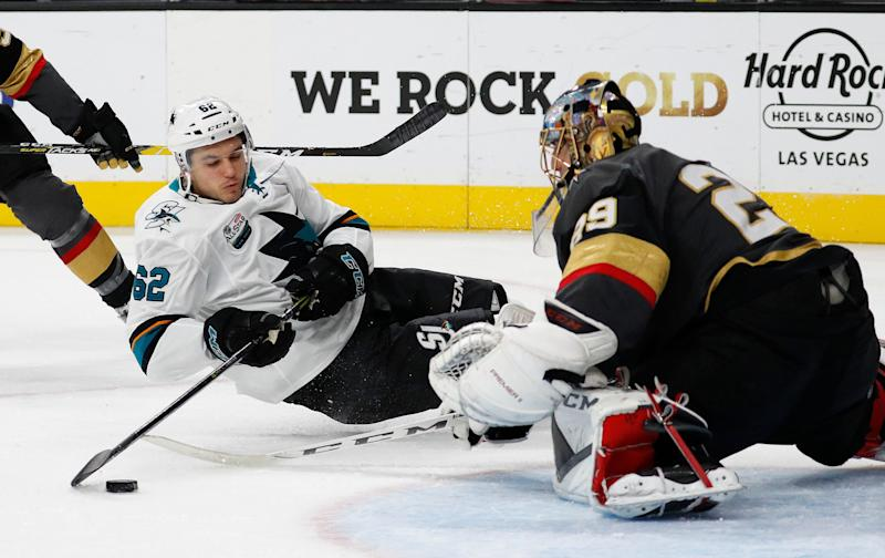 San Jose Sharks right wing Kevin Labanc (62) falls while trying to shoot on Vegas Golden Knights goaltender Marc-Andre Fleury (29) during the third period of an NHL hockey game Saturday, Nov. 24, 2018, in Las Vegas. (AP Photo/John Locher)