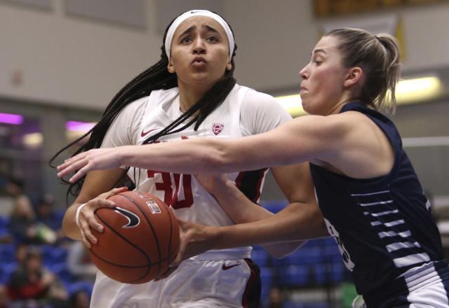 Stanford's Haley Jones goes for the basket as California Baptist's Georgia Dale defends during first-quarter NCAA college basketball game action at the Victoria Invitational in Victoria, British Columbia, Thursday, Nov. 28, 2019. (Chad Hipolito/The Canadian Press via AP)
