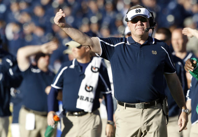 Notre Dame head coach Brian Kelly directs his team against Air Force in the second quarter of an NCAA college football game in Air Force Academy, Colo., Saturday, Oct. 26, 2013. (AP Photo/David Zalubowski)