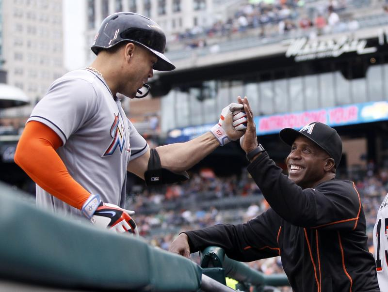 Giancarlo Stanton, left, with then-Marlins hitting coach Barry Bonds last season. (AP)