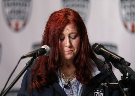Renee Elliott who lost her job at Carrier speaks about her disappointment in President Donald Trump at an event hosted by Good Jobs Nation at a bar across from Carrier Corporation HVAC manufacturing plant ahead of an expected second-round of layoffs in Indianapolis, Indiana, U.S., January 10, 2018.  Photo taken January 10, 2018. REUTERS/Chris Bergin