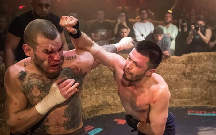 Danik Vesnenok and Danila Utenkov fight during the 'Top Dog' bare-knuckle boxing tournament in Moscow - Reuters